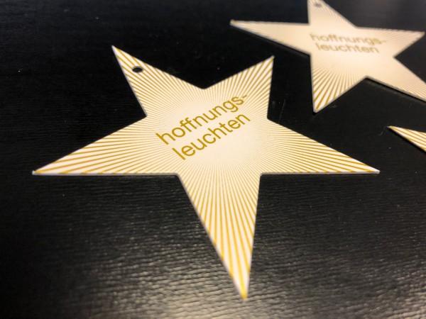 Goldener Stern zum #hoffnungsleuchten