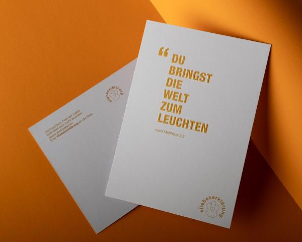 """Komplimente-Postkarte für Weihnachten """"Du bringst die Welt zum Leuchten"""""""
